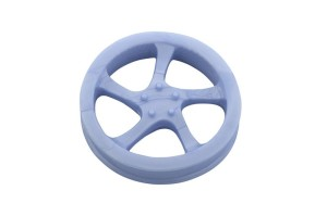 Rubber dog toy in a shape of a car rim, floats in water