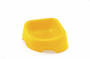 Plastic dog bowl in a shape of a triangle to use for room corners